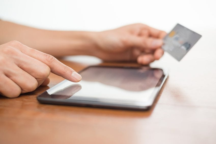 Online-shopping-using-digital-tablet-and-credit-card